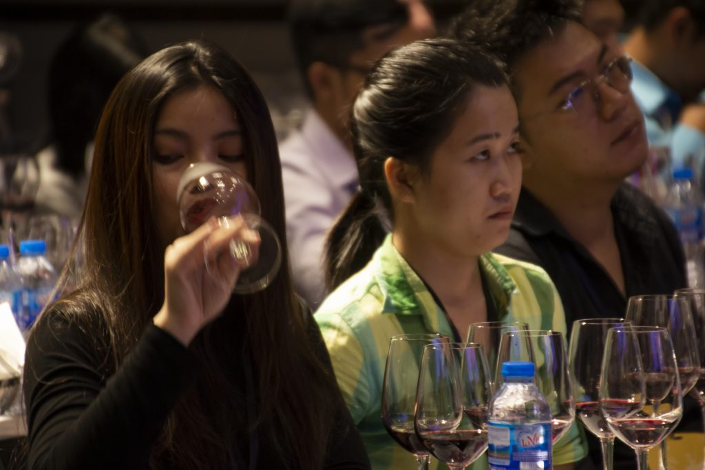 Importer from Vietnam tasting a glass of manchego wine